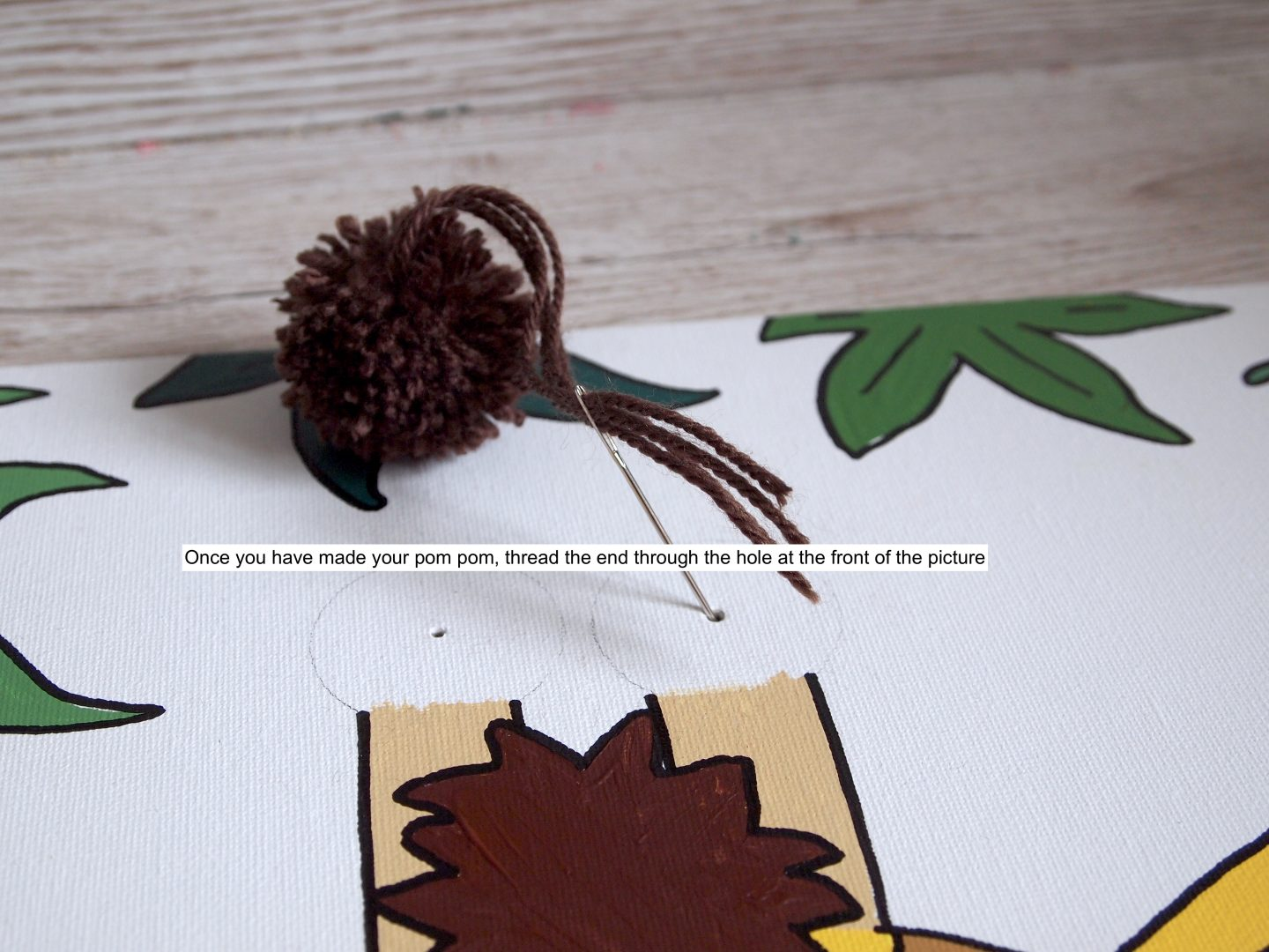 adding pom pom and painting the giraffe canvas art