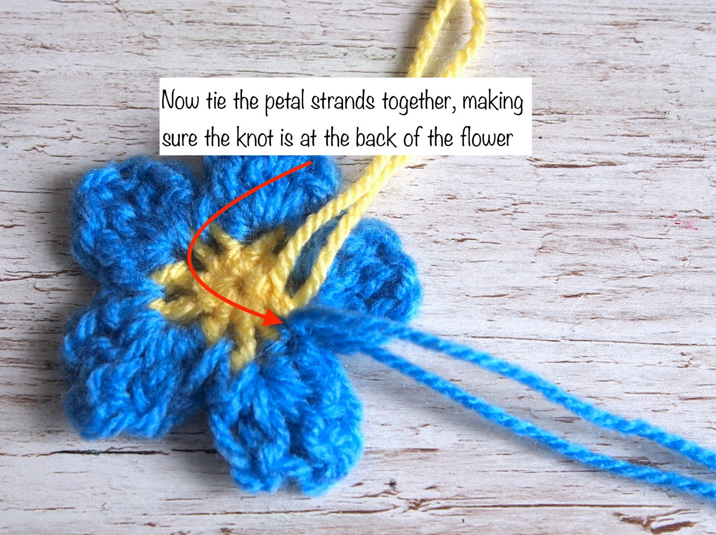 adding petal to crochet flower for forget me not crochet wreath