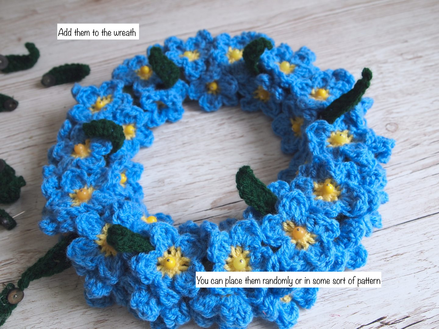 putting leaves on forget me not crochet wreath