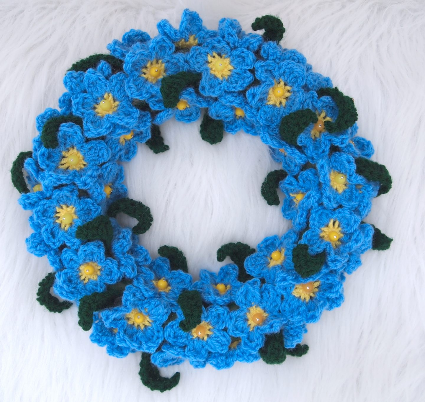 completed forget me not crochet wreath