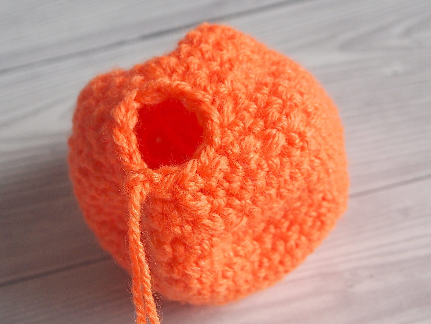 shaping the bottom of pumkin for crochet pumpkin tutorial