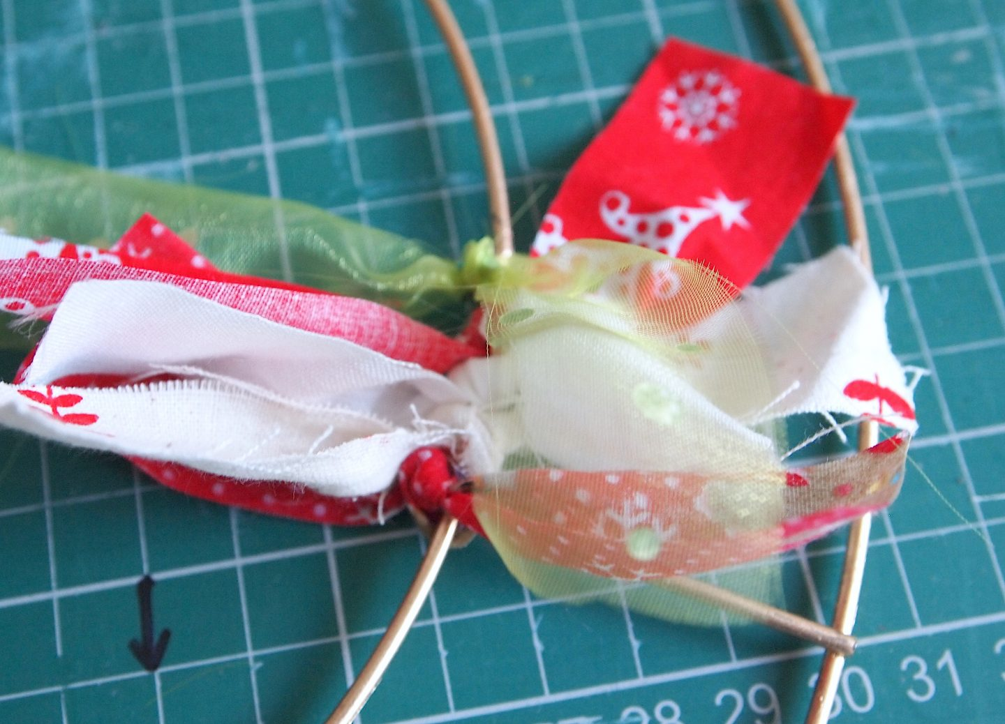 attaching strips to rag wreath