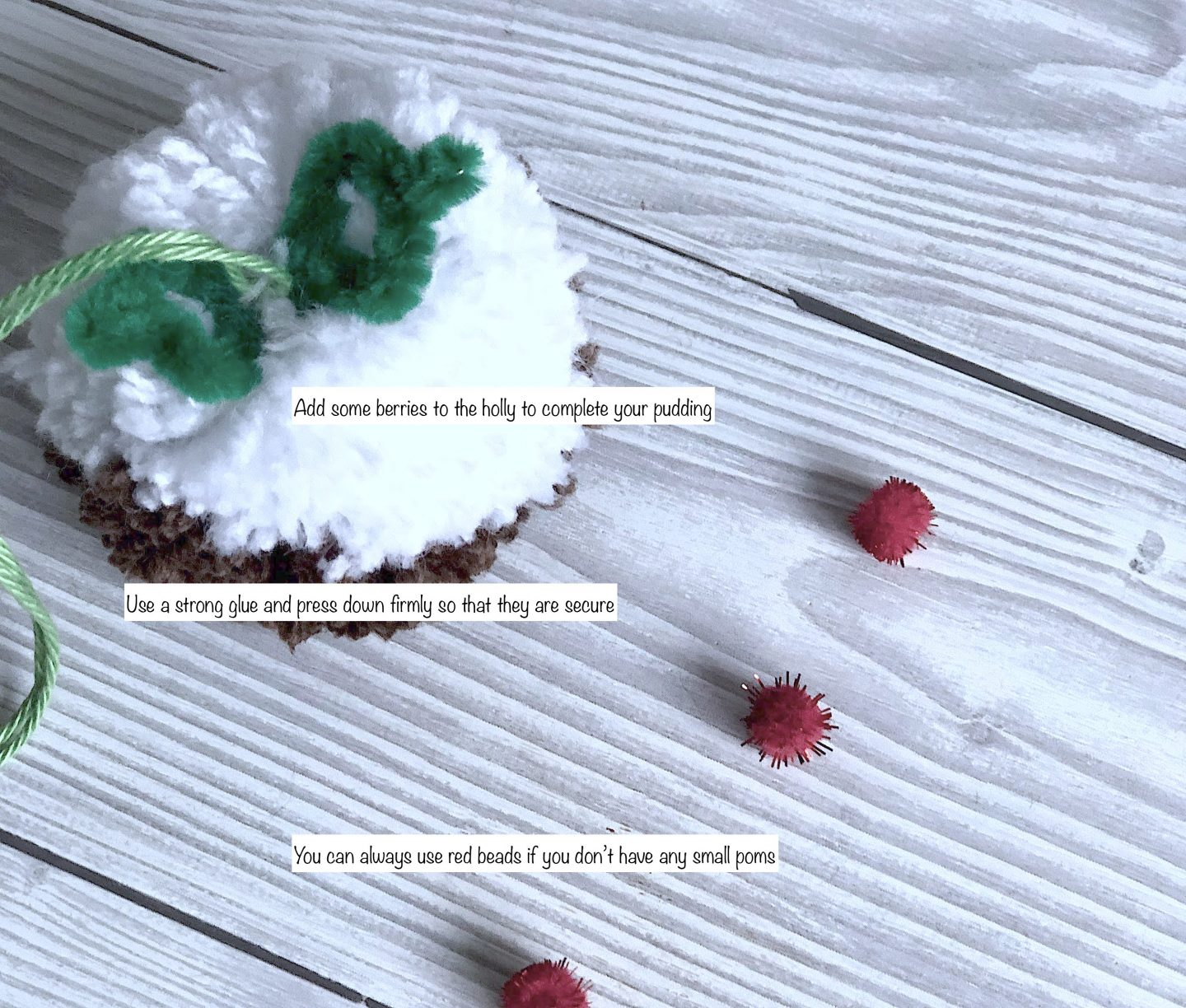 adding berries to a christmas pudding pom pom
